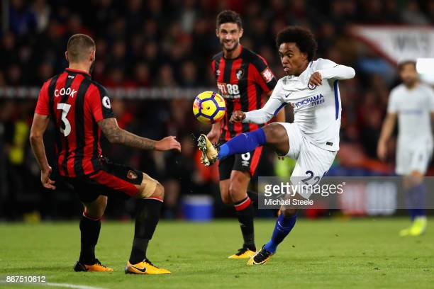 Willian of Chelsea controls the ball infront of Steve Cook of AFC Bournemouth during the Premier League match between AFC Bournemouth and Chelsea at...