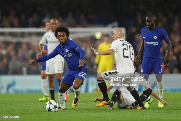 Willian of Chelsea escapes a challenge from Oliveira Richard of Qarabag FK during the UEFA Champions League Group C match between Chelsea FC and...