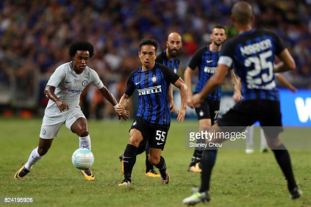 Willian of Chelsea FC battles with Yuto Nagatomo of FC Internazionale during the International Champions Cup match between FC Internazionale and...