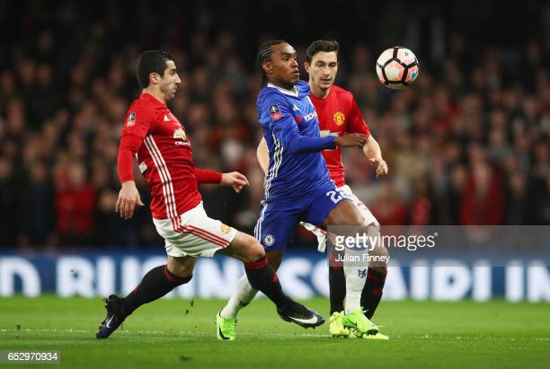 Willian of Chelsea goes between Henrikh Mkhitaryan and Matteo Darmian of Manchester United during The Emirates FA Cup QuarterFinal match between...