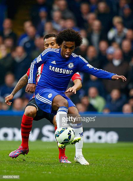 Willian of Chelsea holds off a challenge from Ryan Bertrand of Southampton during the Barclays Premier League match between Chelsea and Southampton...