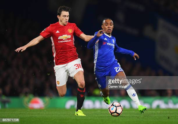 Willian of Chelsea holds off Matteo Darmian of Manchester United during The Emirates FA Cup QuarterFinal match between Chelsea and Manchester United...
