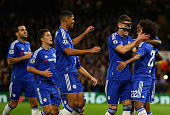 Willian of Chelsea is congratulated by Gary Cahill and Ruben LoftusCheek of Chelsea on scoring the opening goal during the UEFA Chanmpions League...