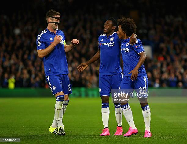 Willian of Chelsea is congratulated on scoring the opening goal by Baba Rahman and Gary Cahill of Chelsea during the UEFA Chanmpions League group G...