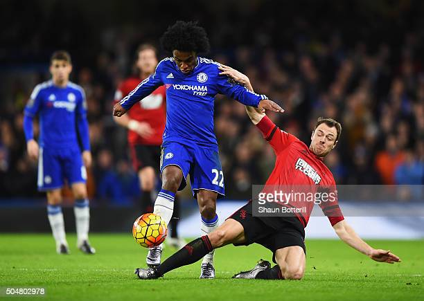 Willian of Chelsea is tackled by Jonny Evans of West Bromwich Albion during the Barclays Premier League match between Chelsea and West Bromwich...