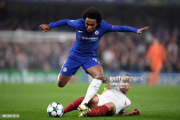 Willian of Chelsea is tackled by Radja Nainggolan of AS Roma during the UEFA Champions League group C match between Chelsea FC and AS Roma at...