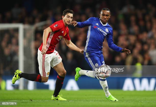 Willian of Chelsea is watched by Matteo Darmian of Manchester United during The Emirates FA Cup QuarterFinal match between Chelsea and Manchester...