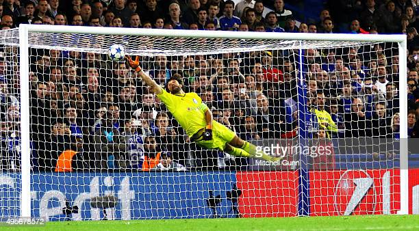 Willian of Chelsea scores a goal past a diving goalkeeper Oleksandr Shovkovskiy of Dynamo Kyiv during the Champions League match between Chelsea and...