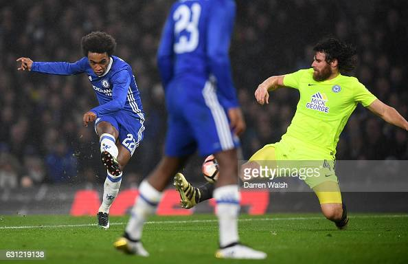Willian of Chelsea scores his sides third goal during The Emirates FA Cup Third Round match between Chelsea and Peterborough United at Stamford...