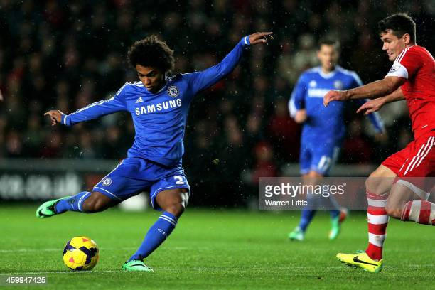 Willian of Chelsea scores his team's second goal during the Barclays Premier League match between Southampton and Chelsea at St Mary's Stadium on...