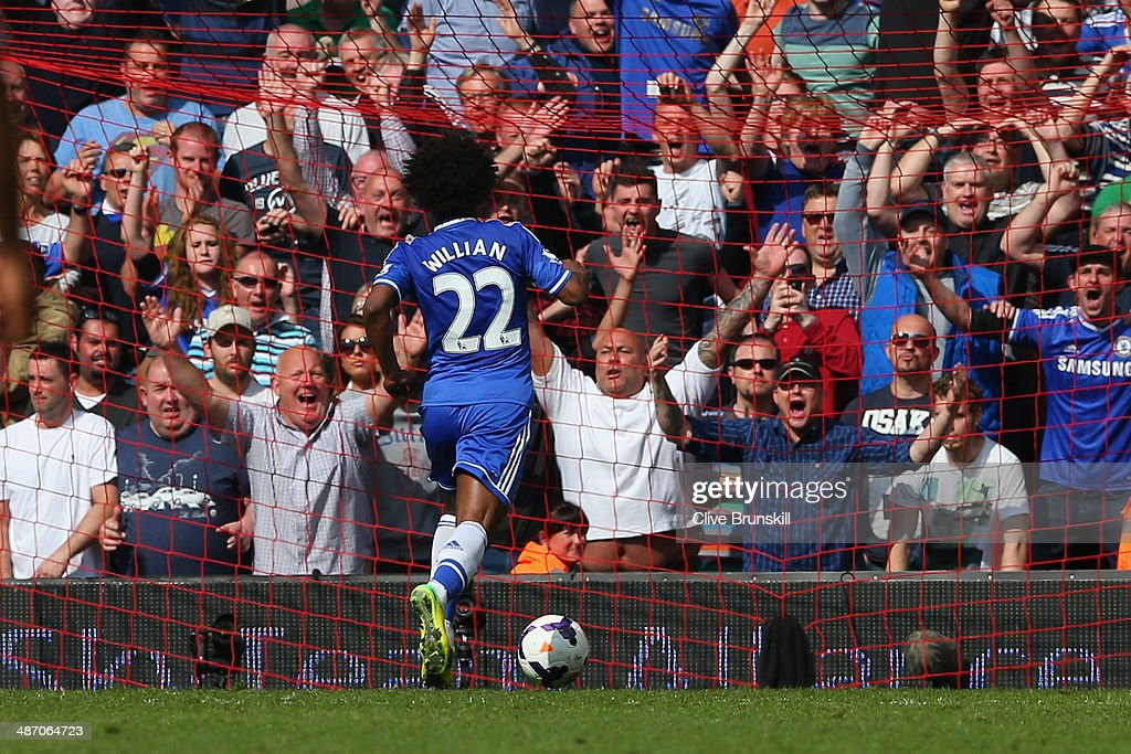 Willian of Chelsea scores their second goal during the Barclays Premier League match between Liverpool and Chelsea at Anfield on April 27, 2014 in Liverpool, England.