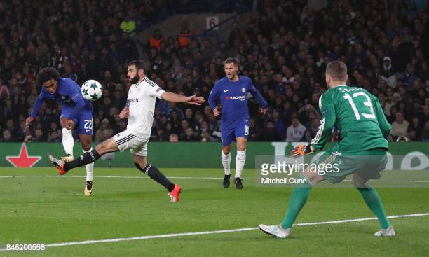 Willian of Chelsea takes a shot at goal during the UEFA Champions League group C match between Chelsea FC and Qarabag FK at Stamford Bridge on...