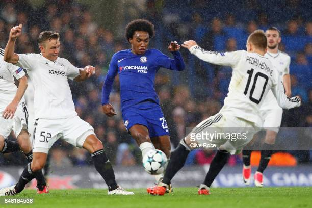 Willian of Chelsea takes on Jakub Rzezniczak of Qarabag FK during the UEFA Champions League Group C match between Chelsea FC and Qarabag FK at...