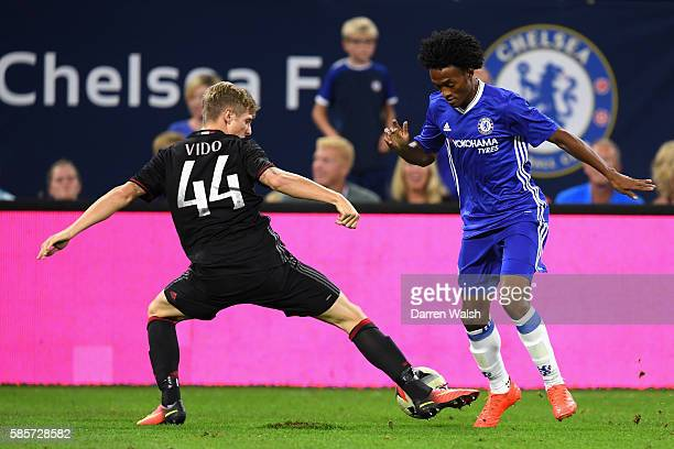 Willian of Chelsea takes on Luca Vido of AC Milan during the 2016 International Champions Cup match between Chelsea and AC Milan at US Bank Stadium...