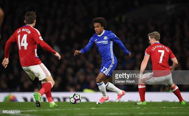 Willian of Chelsea takes on Marten de Roon and Grant Leadbitter of Middlesbrough during the Premier League match between Chelsea and Middlesbrough at...