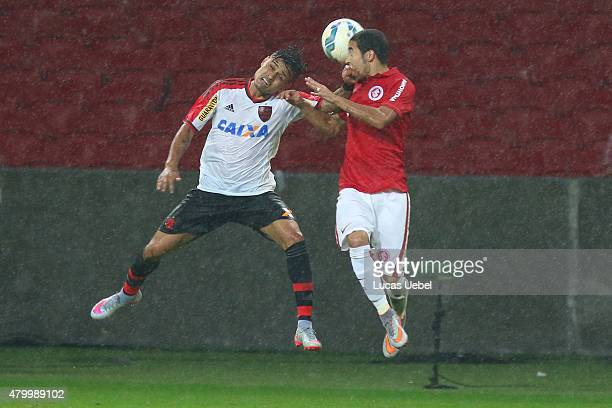 Willian of Internacional battles for the ball against Everton of Flamengo during the match between Internacional and Flamengo as part of Brasileirao...
