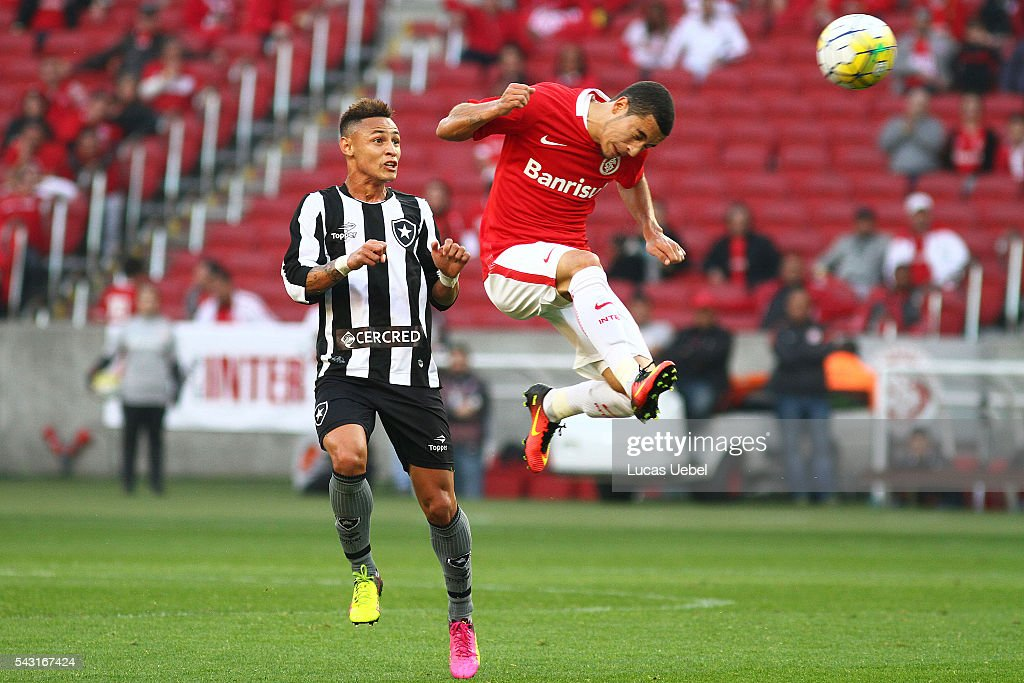 Willian of Internacional battles for the ball against <a gi-track='captionPersonalityLinkClicked' href=/galleries/search?phrase=Neilton&family=editorial&specificpeople=11120836 ng-click='$event.stopPropagation()'>Neilton</a> of Botafogo during the match between Internacional and Botafogo as part of Brasileirao Series A 2016, at Estadio Beira-Rio on June 26, 2016, in Porto Alegre, Brazil.