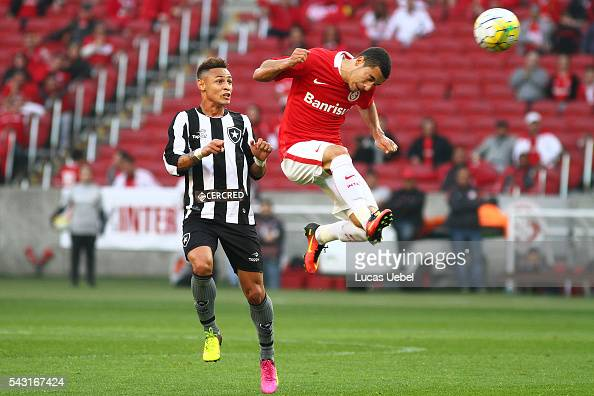 Willian of Internacional battles for the ball against Neilton of Botafogo during the match between Internacional and Botafogo as part of Brasileirao...