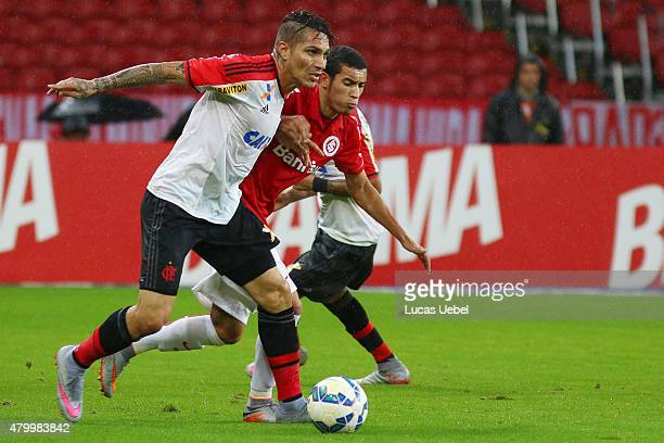 Willian of Internacional battles for the ball against Paolo Guerrero of Flamengo during the match between Internacional and Flamengo as part of...