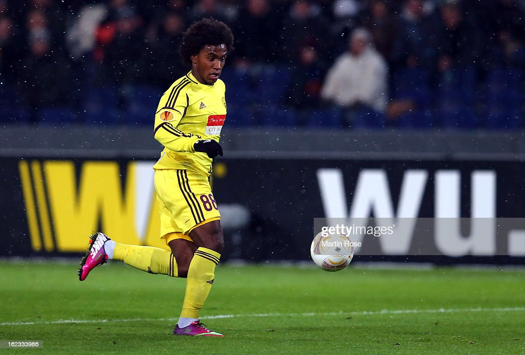 Willian of Makhachkala battle for the ball during the UEFA Europa League Round of 32 second leg match between Hannover 96 and Anji Makhachkala at AWD Arena on February 21, 2013 in Hannover, Germany.