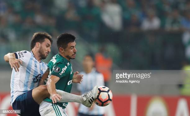 Willian of Palmeiras in action against Canuto of Atletico Tucuman during Copa Libertadores of America match between Palmeiras and Atletico Tucuman in...