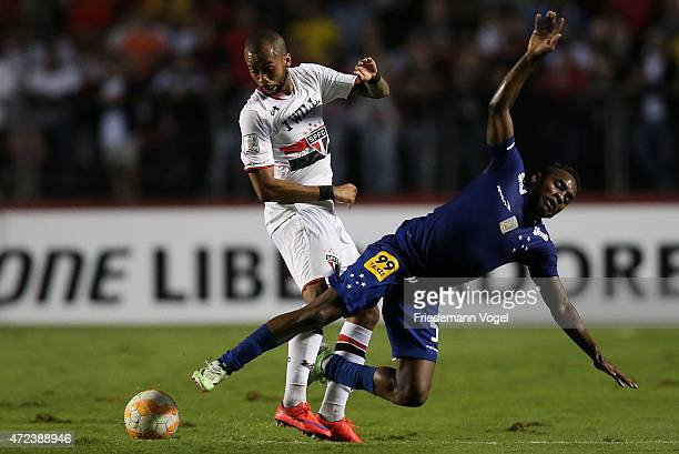 Willians of Cruzeiro fights for the ball with Wesley of Sao Paulo during a first leg match between between Sao Paulo and Cruzeiro as part of round of...