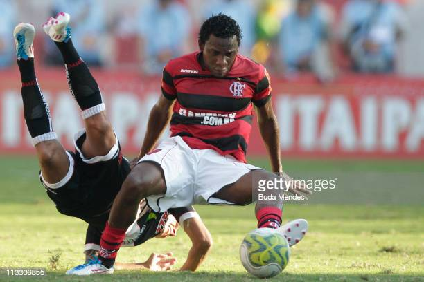 Willians of Flamengo struggles for the ball with Ramon of Vasco during a match as part of Rio de Janeiro State Championship 2011 at Engenhao stadium...