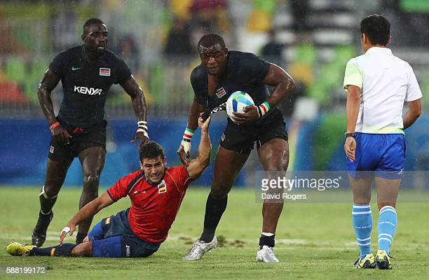 Willie Ambaka of Kenya is tackled by Francisco Hernandez of Spain in action during the Men's Placing 912 Match 20 between Spain and Kenya on Day 5 of...