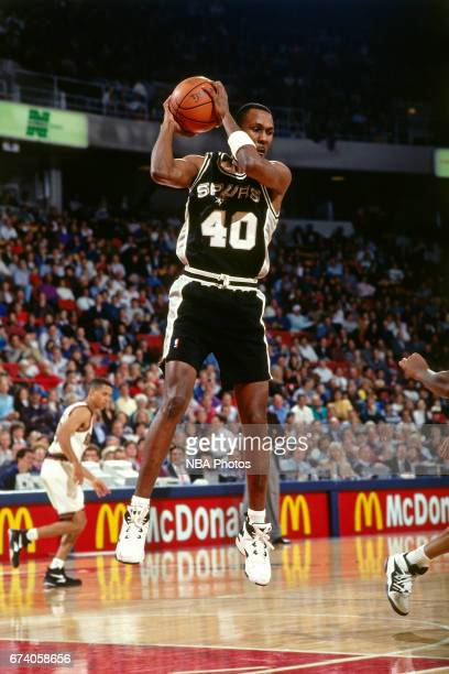 Willie Anderson of the San Antonoi Spurs rebounds against the Denver Nuggets circa 1994 at the McNichols Sports Arena in Denver Colorado NOTE TO USER...