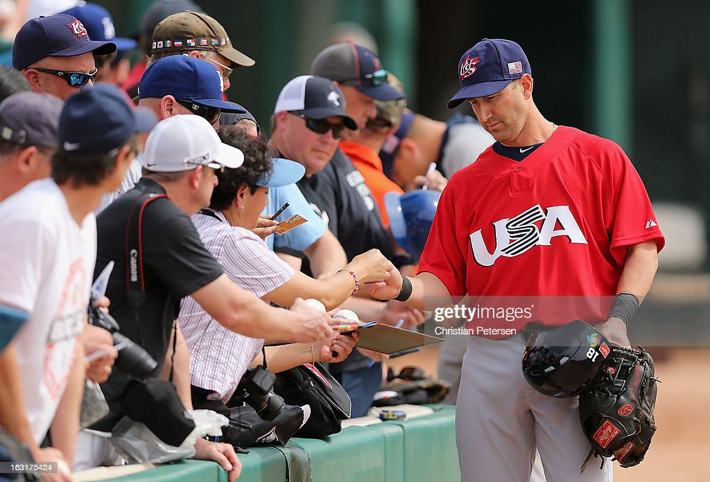 <a gi-track='captionPersonalityLinkClicked' href=/galleries/search?phrase=Willie+Bloomquist&family=editorial&specificpeople=214000 ng-click='$event.stopPropagation()'>Willie Bloomquist</a> #18 of Team USA signs autographs for fans before the spring training game against the Chicago White Sox at Camelback Ranch on March 5, 2013 in Glendale, Arizona.