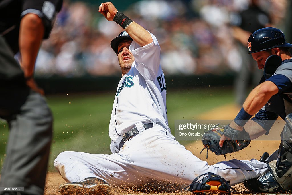 Willie Bloomquist #8 of the Seattle Mariners is tagged out by catcher Bryan Holaday #50 of the Detroit Tigers attempt to score from third base in the third inning at Safeco Field on June 1, 2014 in Seattle, Washington.