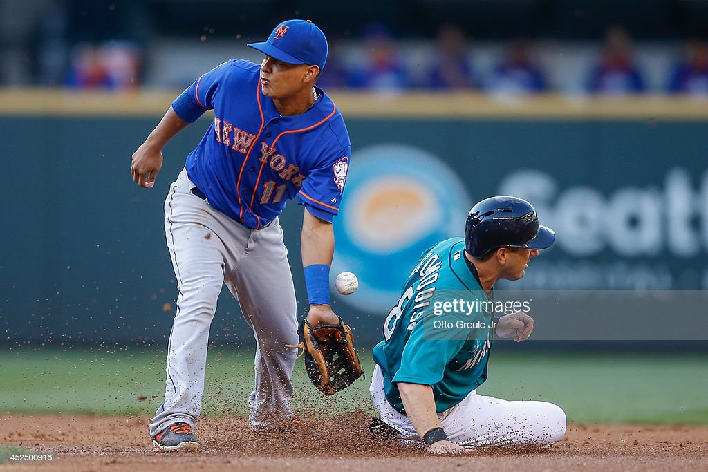 Willie Bloomquist #8 of the Seattle Mariners steals second base against shortstop Ruben Tejada #11 of the New York Mets in the first inning at Safeco Field on July 21, 2014 in Seattle, Washington.