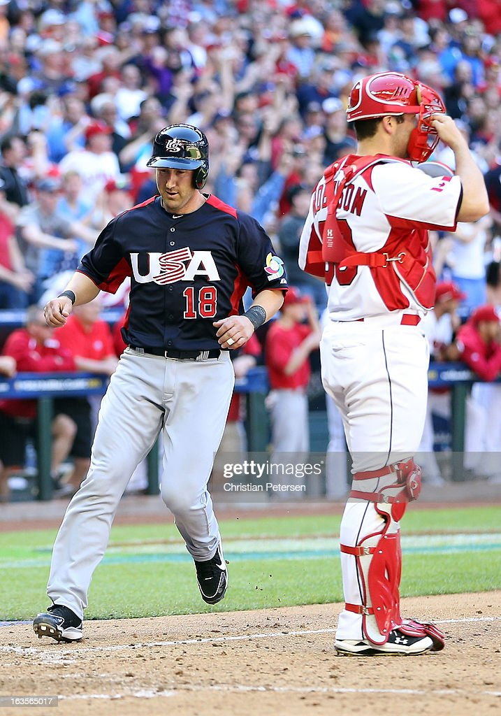 Willie Bloomquist #18 of USA scores a run past catcher Chris Robinson #30 of Canada during the World Baseball Classic First Round Group D game at Chase Field on March 10, 2013 in Phoenix, Arizona. USA defeated Canada 9-4.