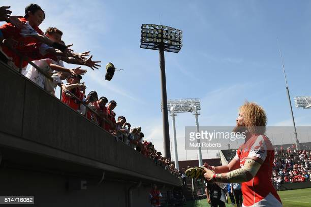 Willie Britz of the Sunwolves gives his boots away to fans after the Super Rugby match between the Sunwolves and the Blues at Prince Chichibu Stadium...