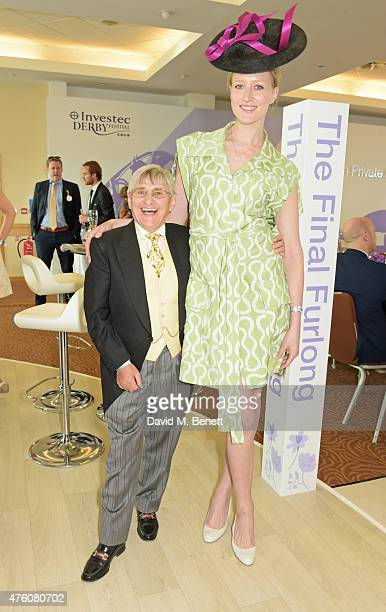 Willie Carson and Jade Parfitt attend Derby Day during the Investec Derby Festival at Epsom Racecourse on June 6 2015 in Epsom England