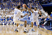 Willie CauleyStein and Tyler Ulis of the Kentucky Wildcats defend Marcus Paige of the North Carolina Tar Heels during the game at Rupp Arena on...