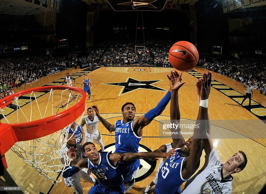 Willie Cauley-Stein #15, James Young #1, and Julius Randle #30 of the Kentucky Wildcats jump for a rebound against the Vanderbilt Commodores at Memorial Gym on January 11, 2014 in Nashville, Tennessee.
