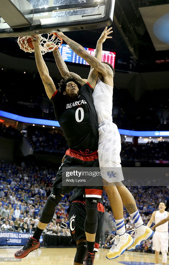 <a gi-track='captionPersonalityLinkClicked' href=/galleries/search?phrase=Willie+Cauley-Stein&family=editorial&specificpeople=9854040 ng-click='$event.stopPropagation()'>Willie Cauley-Stein</a> #15 of the Kentucky Wildcats dunks on Quadri Moore #0 of the Cincinnati Bearcats during the third round of the 2015 NCAA Men's Basketball Tournament at KFC YUM! Center on March 21, 2015 in Louisville, Kentucky.