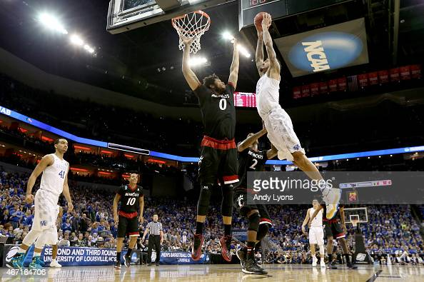 Willie CauleyStein of the Kentucky Wildcats dunks on Quadri Moore of the Cincinnati Bearcats during the third round of the 2015 NCAA Men's Basketball...