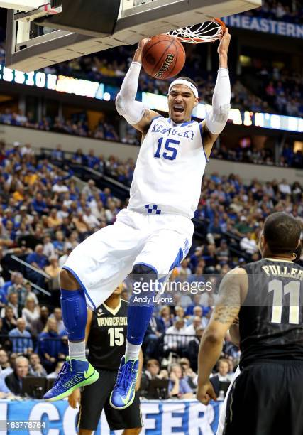 Willie CauleyStein of the Kentucky Wildcats dunks the ball against the Vanderbilt Commodores in the first half during the Quarterfinals of the SEC...