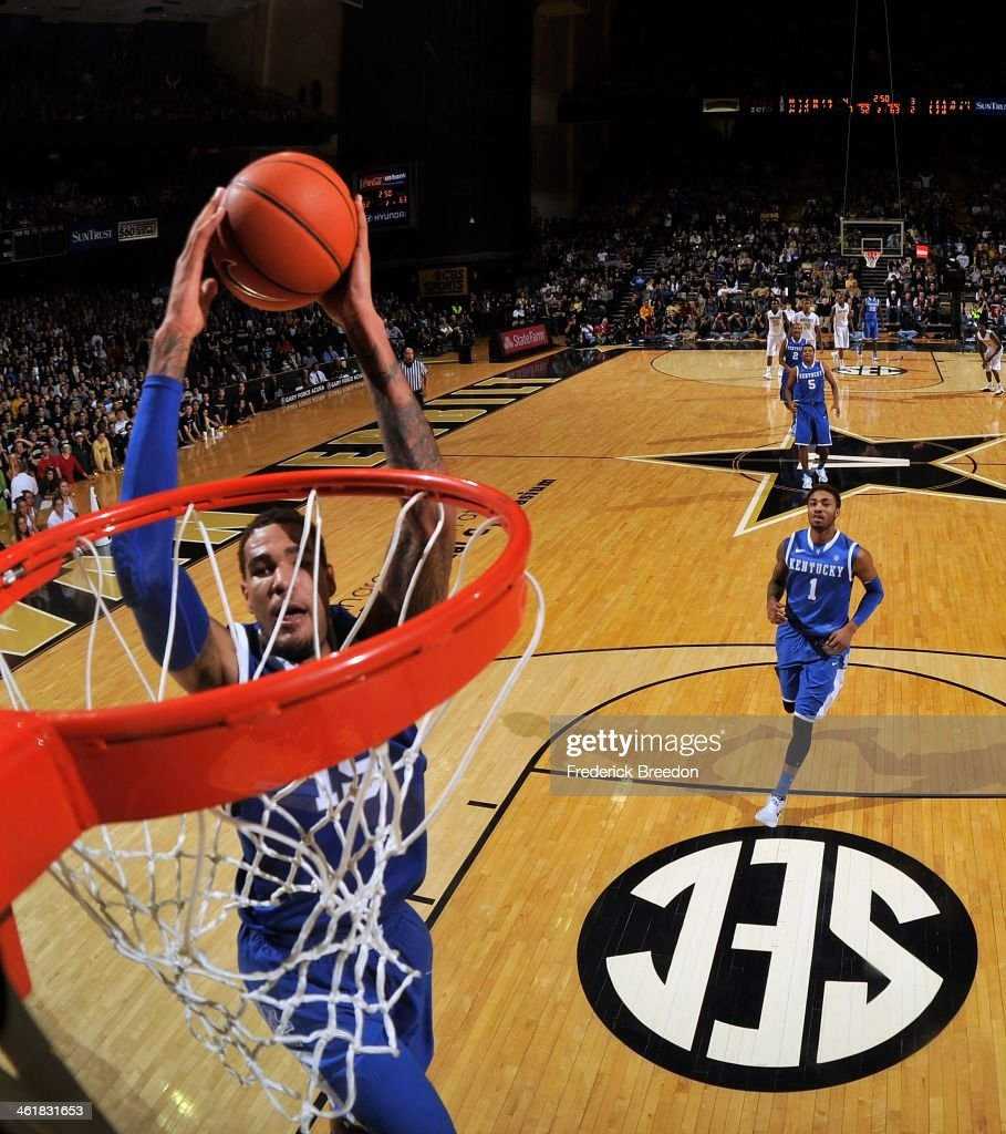 Willie Cauley-Stein #15 of the Kentucky Wildcats dunks the ball as James Young #1 trails the play against the Vanderbilt Commodores at Memorial Gym on January 11, 2014 in Nashville, Tennessee.