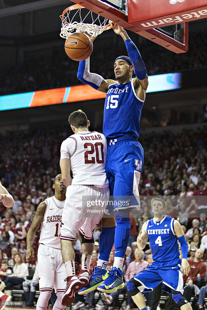 Willie Cauley-Stein #15 of the Kentucky Wildcats dunks the ball over Kikko Haydar #20 of the Arkansas Razorbacks at Bud Walton Arena on March 2, 2013 in Fayetteville, Arkansas. The Razorbacks defeated the Wildcats 73-60.