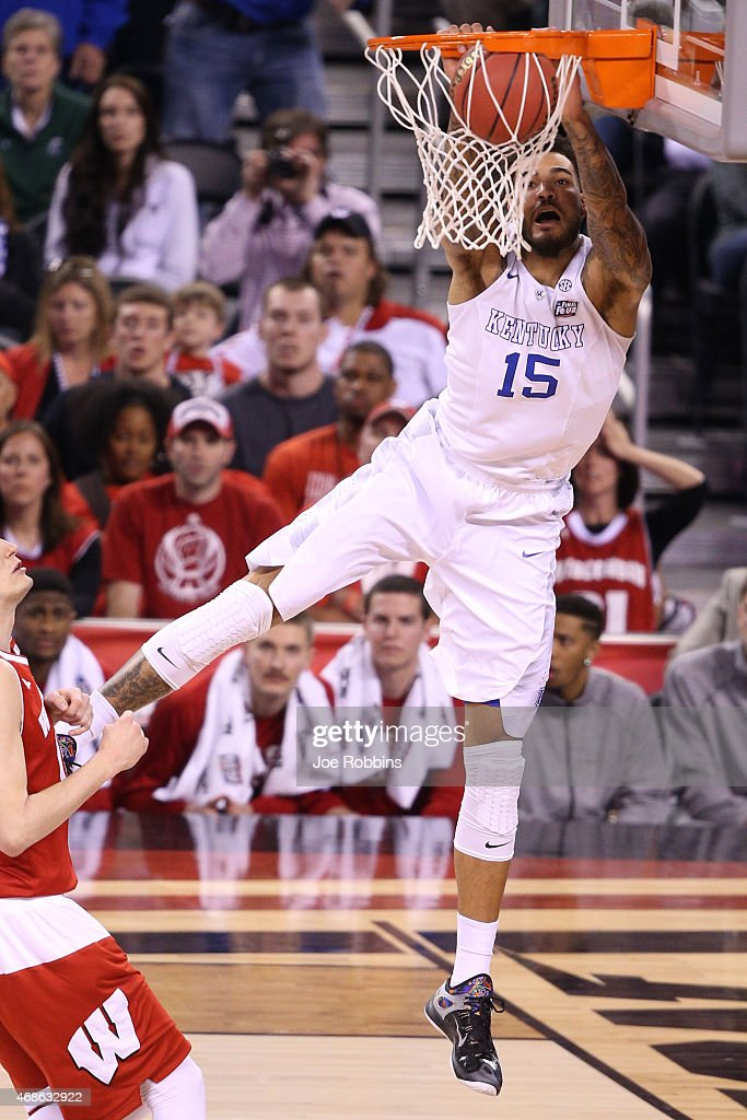 <a gi-track='captionPersonalityLinkClicked' href=/galleries/search?phrase=Willie+Cauley-Stein&family=editorial&specificpeople=9854040 ng-click='$event.stopPropagation()'>Willie Cauley-Stein</a> #15 of the Kentucky Wildcats goes up for a dunk against <a gi-track='captionPersonalityLinkClicked' href=/galleries/search?phrase=Sam+Dekker&family=editorial&specificpeople=7887140 ng-click='$event.stopPropagation()'>Sam Dekker</a> #15 of the Wisconsin Badgers in the first half during the NCAA Men's Final Four Semifinal at Lucas Oil Stadium on April 4, 2015 in Indianapolis, Indiana.