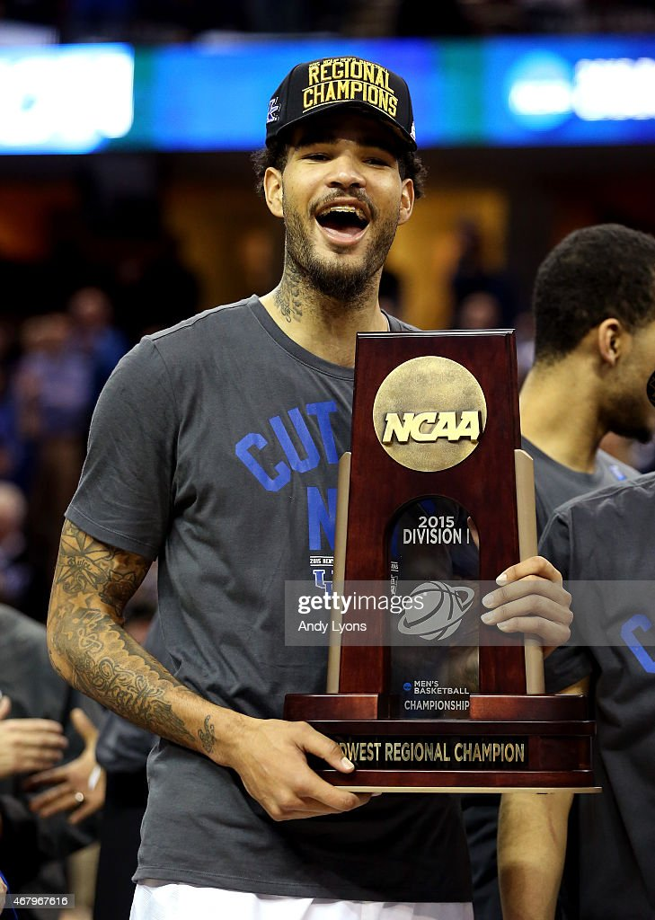 <a gi-track='captionPersonalityLinkClicked' href=/galleries/search?phrase=Willie+Cauley-Stein&family=editorial&specificpeople=9854040 ng-click='$event.stopPropagation()'>Willie Cauley-Stein</a> #15 of the Kentucky Wildcats holds his team's trophy after defeating the Notre Dame Fighting Irish during the Midwest Regional Final of the 2015 NCAA Men's Basketball tournament at Quicken Loans Arena on March 28, 2015 in Cleveland, Ohio.