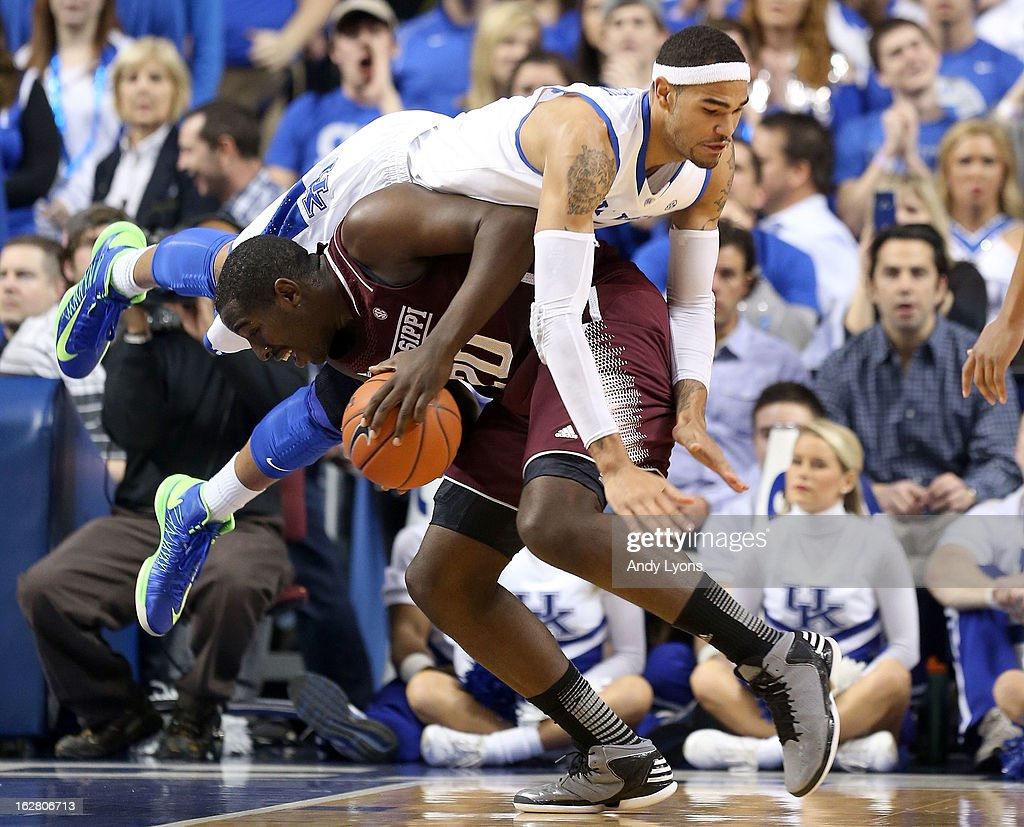 Willie Cauley-Stein #15 of the Kentucky Wildcats lands on Gavin Ware #20 the Mississippi State Bulldogs during the game at Rupp Arena on February 27, 2013 in Lexington, Kentucky.