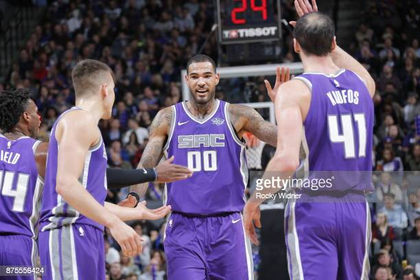 Willie CauleyStein of the Sacramento Kings gives high five to teammates during the game against the Portland Trail Blazers on November 17 2017 at...