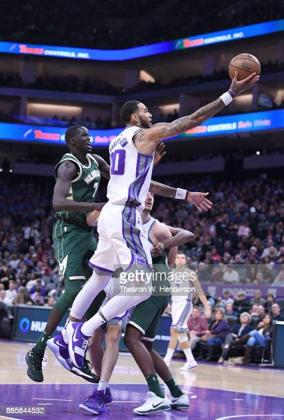 Willie CauleyStein of the Sacramento Kings goes up for a layup over Thon Maker of the Milwaukee Bucks during their NBA basketball game at Golden 1...