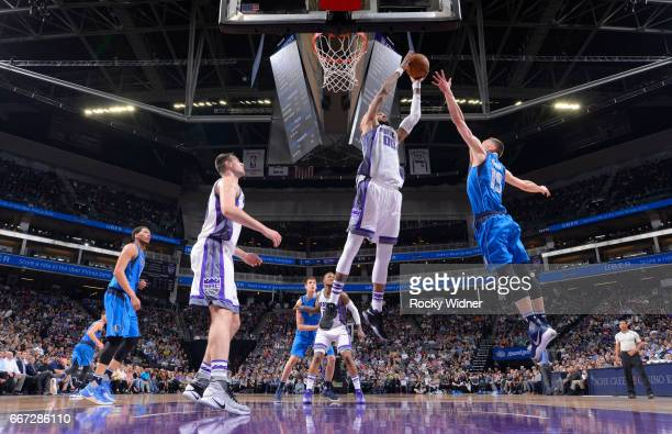 Willie CauleyStein of the Sacramento Kings rebounds against Jarrod Uthoff of the Dallas Mavericks on April 4 2017 at Golden 1 Center in Sacramento...