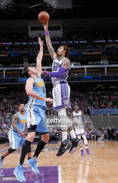 Willie CauleyStein of the Sacramento Kings shoots against Danilo Gallinari of the Denver Nuggets on March 11 2017 at Golden 1 Center in Sacramento...