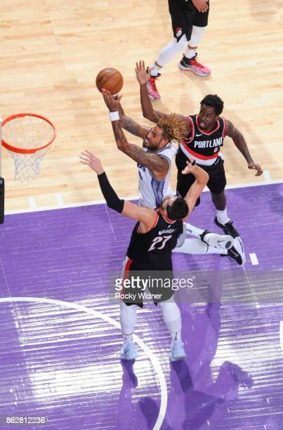 Willie CauleyStein of the Sacramento Kings shoots against Jusuf Nurkic of the Portland Trail Blazers on October 9 2017 at Golden 1 Center in...